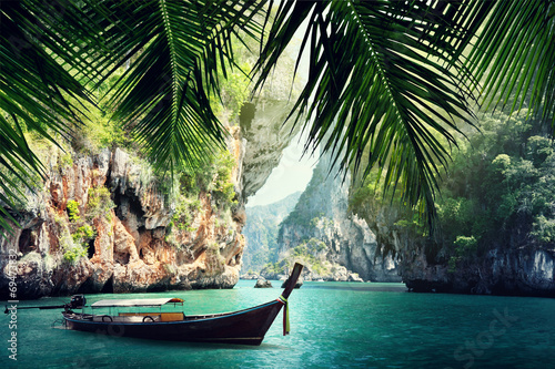Foto auf Gartenposter Strand long boat and rocks on beach in Krabi, Thailand
