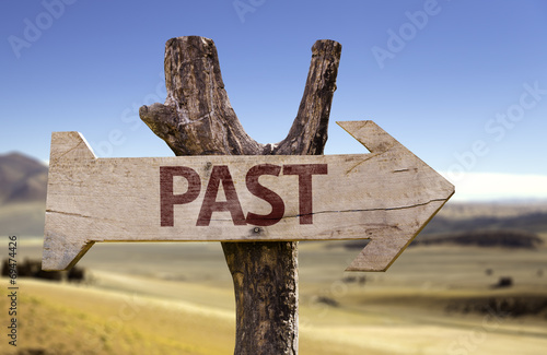 Past wooden sign with a desert background Wallpaper Mural