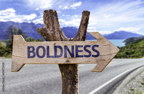 Photo Boldness wooden sign with a street background