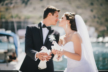 Bride And Groom Posing With Wh...