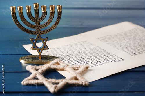 Menorah, star of David and page of Genesis book