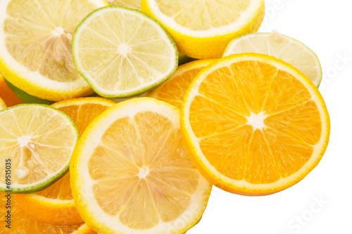 Spoed Foto op Canvas Plakjes fruit Lime, lemon and orange layer slices over white background