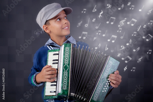 Fotografia, Obraz  little musician playing the accordion