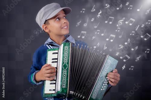 Fotografija  little musician playing the accordion
