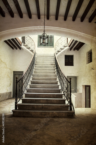 Foto op Plexiglas Trappen Vintage photo of ancient castle interior
