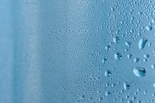 Close-Up Of Water Drops On Blu...