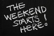 canvas print picture - The weekend starts here! on a blackboard