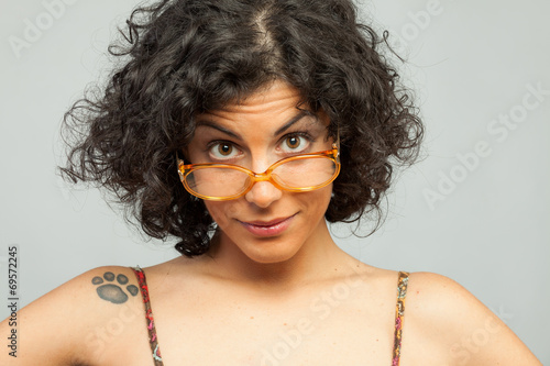 Fototapeta  Surprised sexy brunette with orange glasses