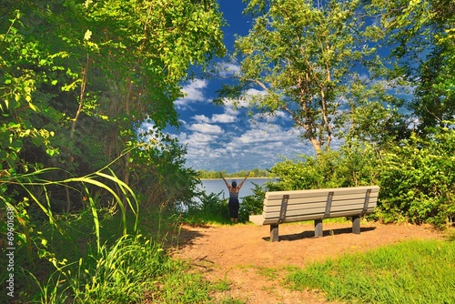 Fototapety, obrazy: Young woman resting on the lake