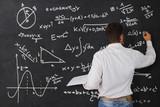 Teacher at the blackboard - 69630608