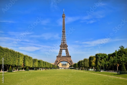 Eiffel Tower, iconic Paris landmark with vibrant blue sky