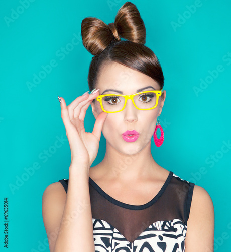 Attractive surprised young woman wearing glasses