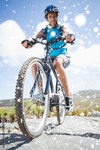 Aluminium Prints Cycling Composite image of fit man cycling on rocky terrain