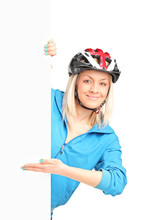 Female Biker With Helmet Stand...