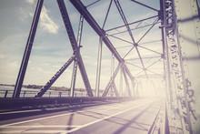 Vintage Stylized Photo Of A Steel Bridge With Sun Light, Torun, Poland.