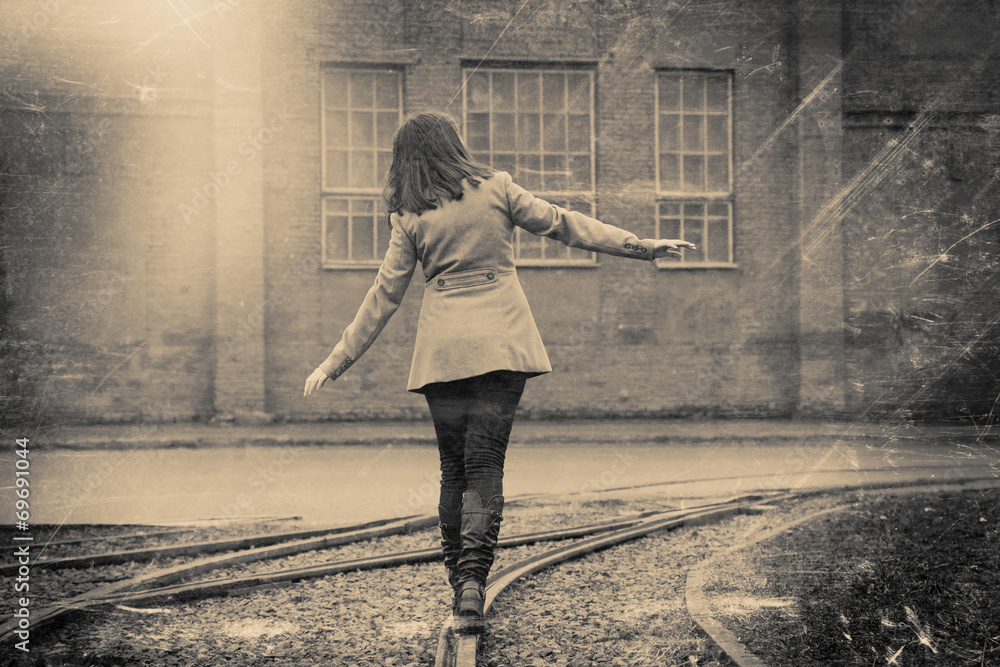 Fototapeta girl walking on the railway, retro stylized photo
