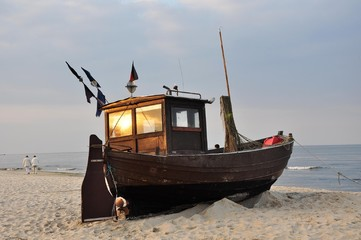 Naklejka Marynistyczny Boot in der Abendsonne