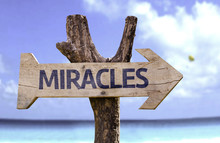 Miracles Wooden Sign With A Beach On Background