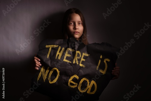 Atheist teen girl holding a banner with the inscription Wallpaper Mural