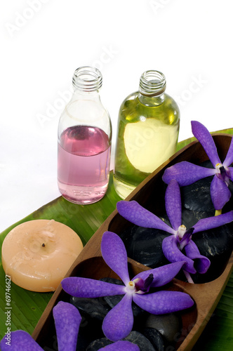 Poster Spa spa collection of aroma oils, flower and black pebbles