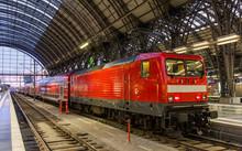 Electric Locomotive With Regional Train In Frankfurt, Germany