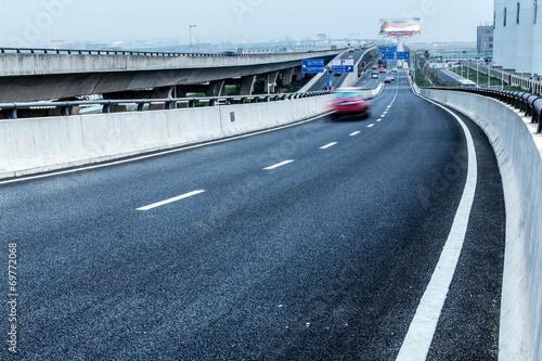 Foto op Plexiglas Motorsport City Expressway under the sun