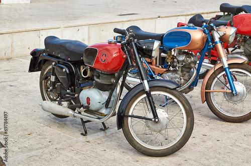 Deurstickers Fiets Old Vintage green motorcycle on the streets