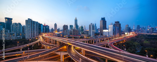 shanghai interchange overpass and elevated road in nightfall Canvas Print