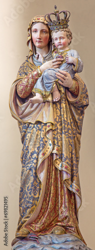 Bruges - polychromed statue of Madonna in st. Giles church - 69821495