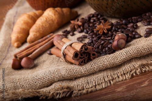 Deurstickers koffiebar cinnamon sticks on the bag close up