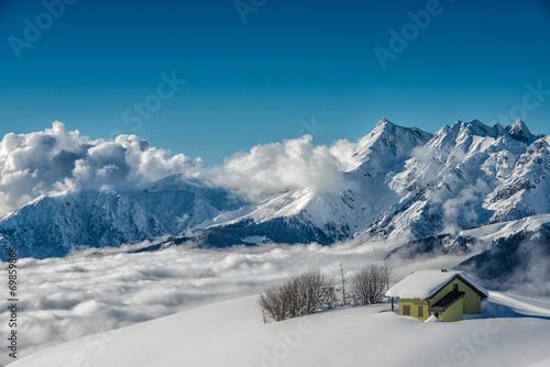 baita in montagna nella neve #69859866