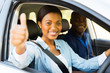 female african learner driver giving thumb up