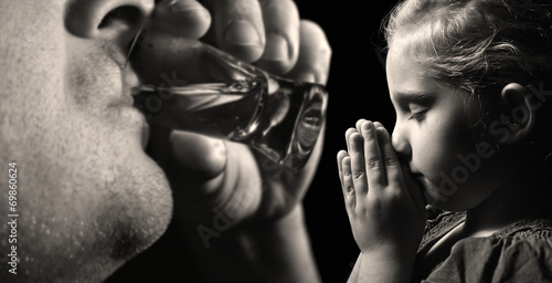 Child prays that father stopped drinking alcohol. Canvas Print