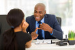 canvas print picture - african american businessman meeting with client