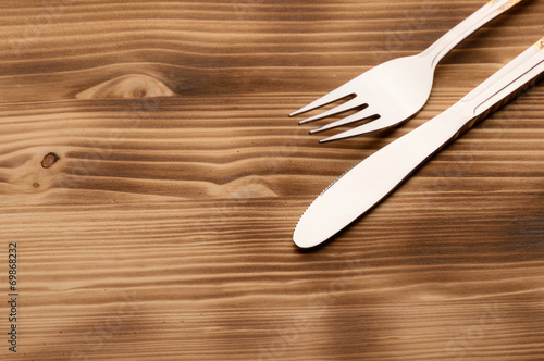 Obraz na plátne Knife and fork set on a wooden vintage table