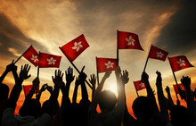 Silhouettes Of People Holding The Flag Of Hong Kong