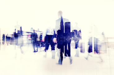 Business People Walking in a City Scape