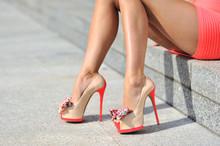 Woman Legs Wearing High Heels. Outdoor Fashion Shoot