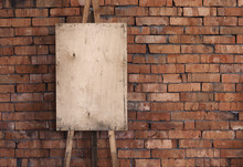 Blank Grunge Easel On A Brick Wall, Art Background