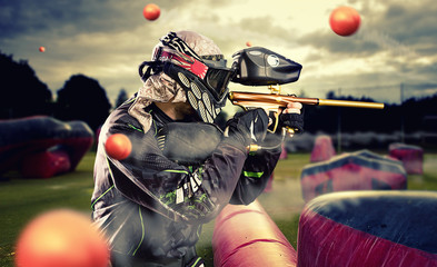 Paintball player in mid gam...