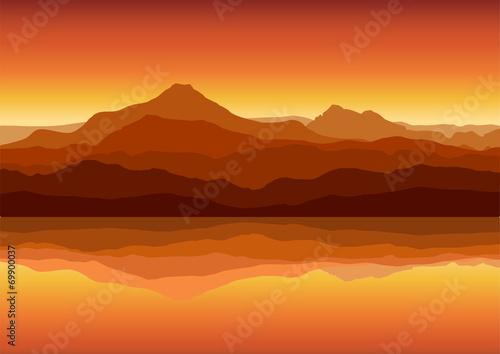 Fotobehang Baksteen Sunset in huge mountains near lake