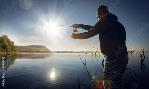 Printed kitchen splashbacks Fishing man fishing on a lake