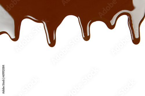 Foto op Canvas Chocolade Melted chocolate dripping on white background