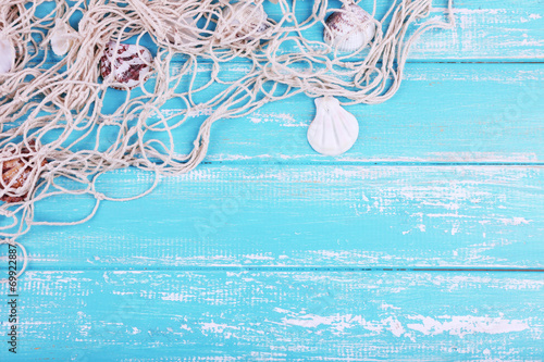Decor of seashells close-up on blue wooden table