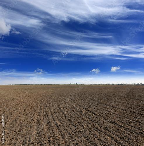 Foto op Plexiglas Platteland ploughed field