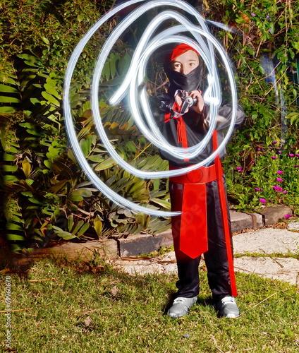 Photo  Ninja boy light painting