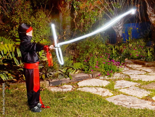 Photo  Ninja with a lightsaber
