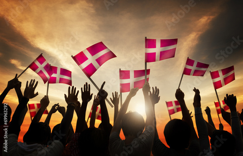 Silhouettes of People Holding the Flag of Denmark Poster