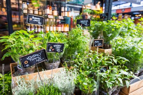 Different fresh green herbs on market in Copenhagen, Denmark. Poster