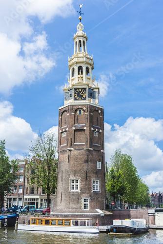 Photo  Montelbaanstoren tower in Amsterdam, Netherlands.